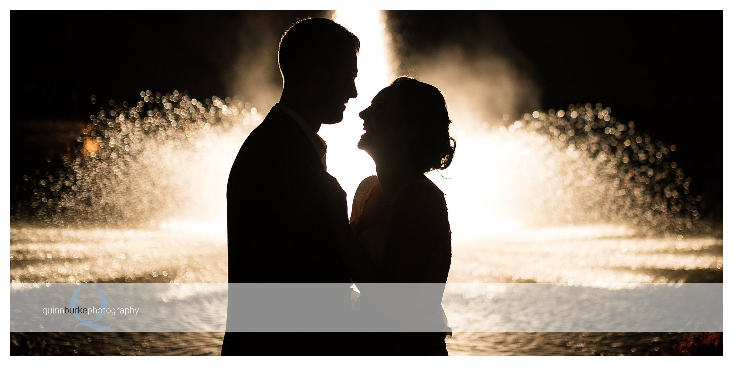 bride and groom in front of zenith vineyard fountain