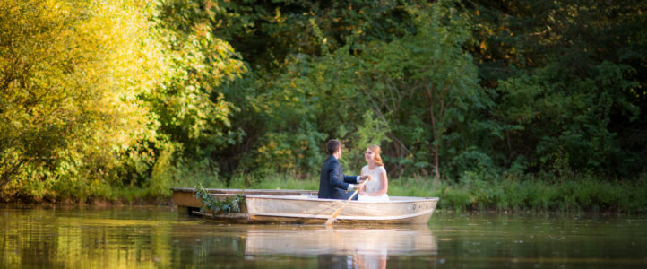 bride and groom boat on pond rons pond wedding