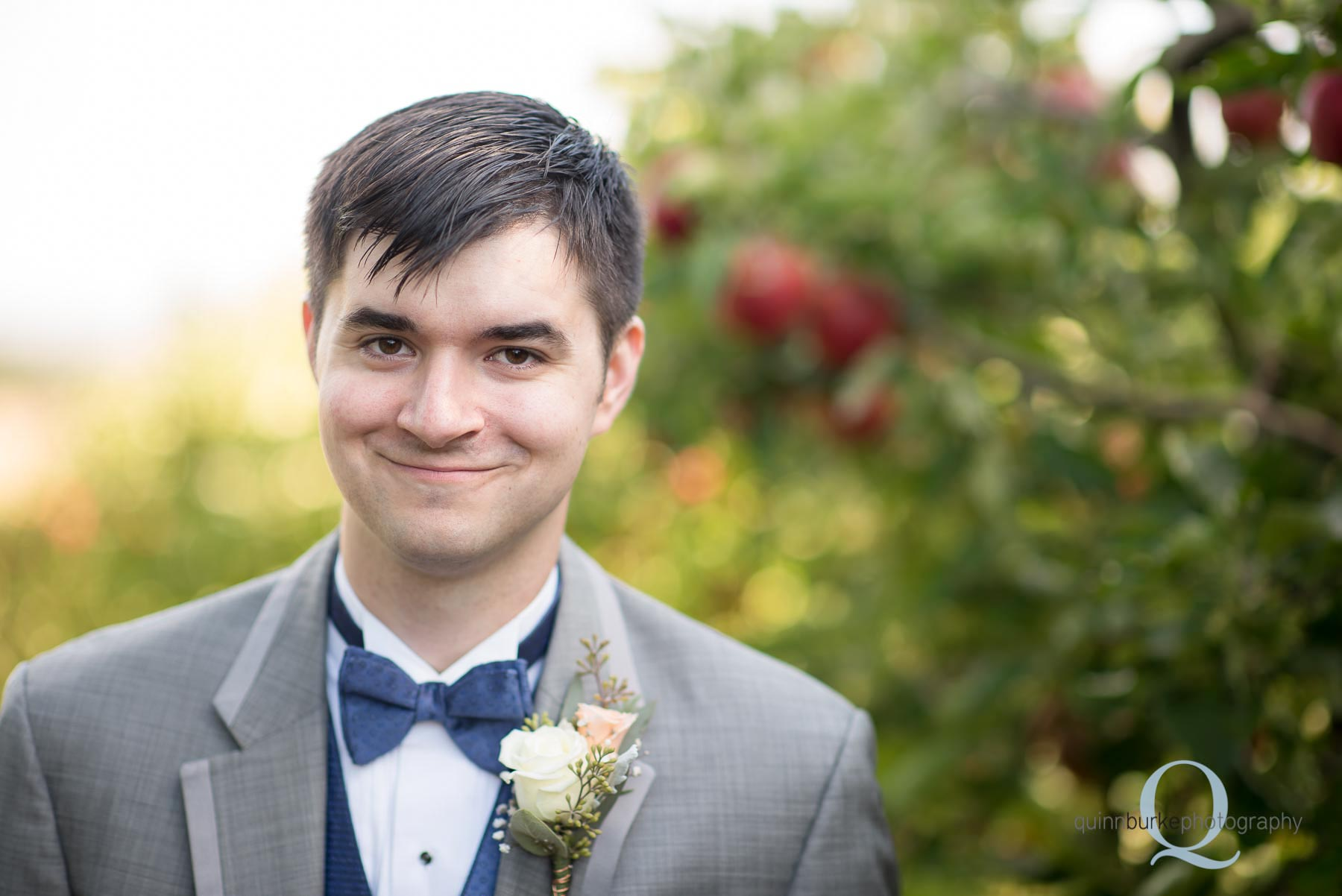 groom in apple orchard in dallas oregon
