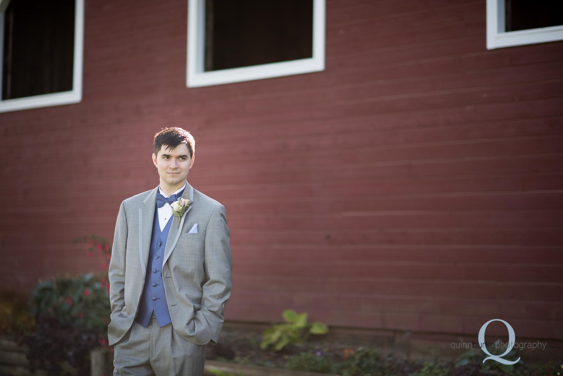 groom outside of barn at Perryhill Farm wedding