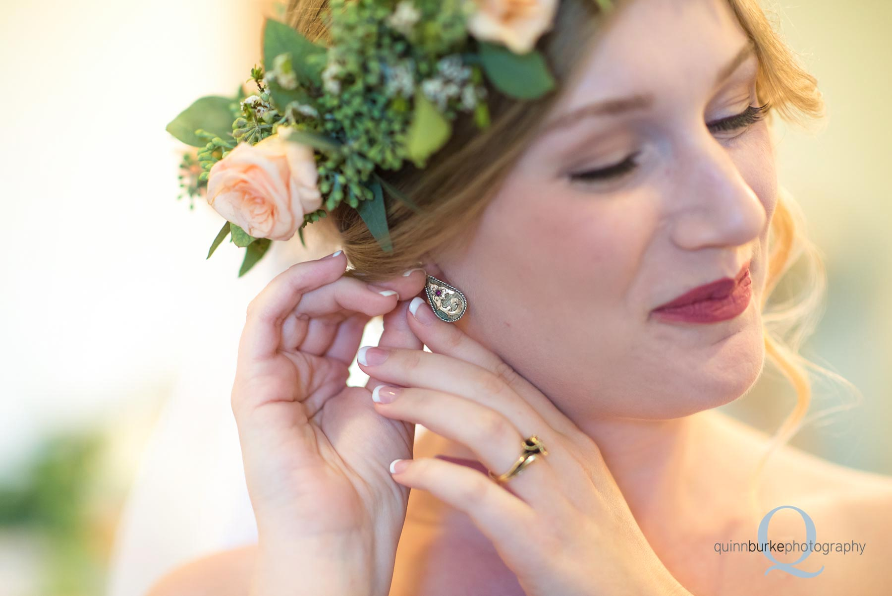 bride putting in earrings at Perryhill Farm