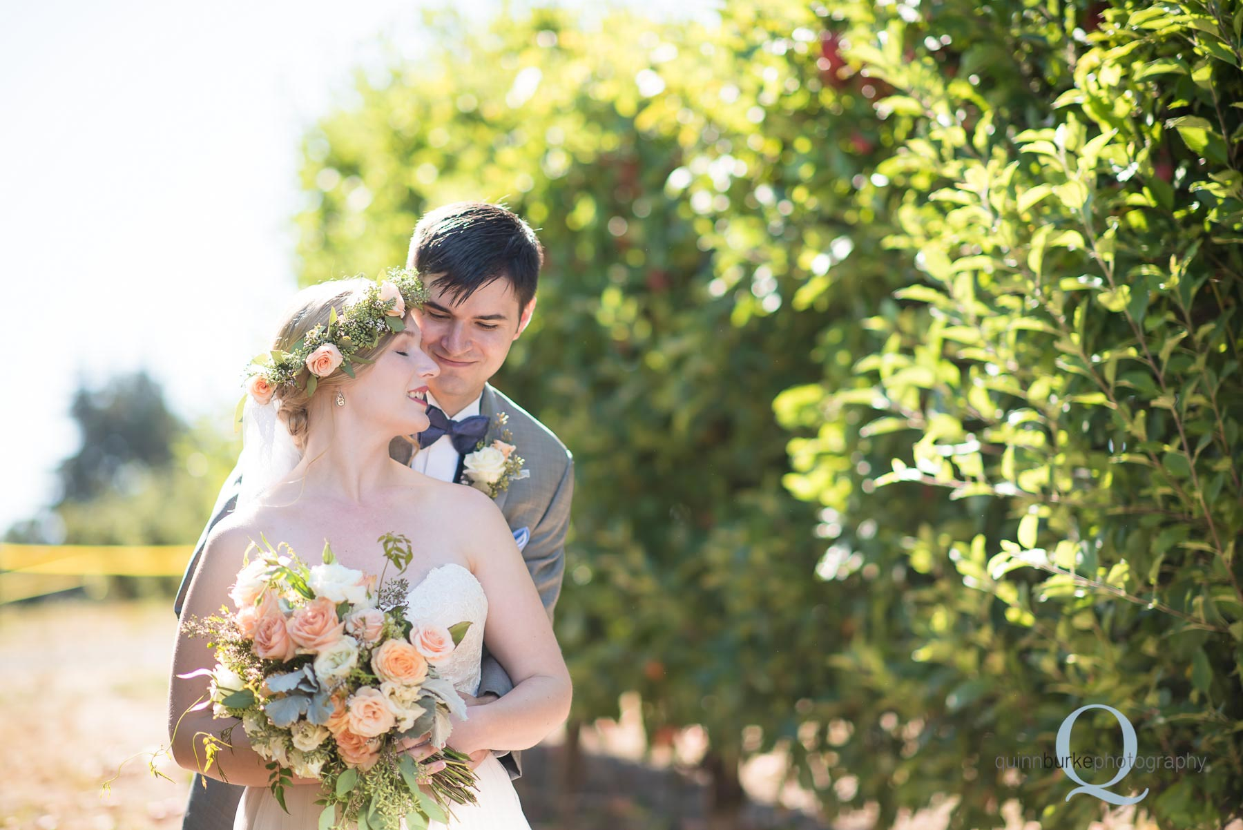 bride and groom in orchard at Perryhill Farm wedding