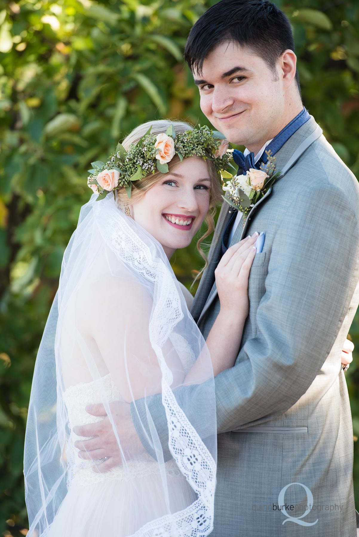 bride and groom portrait in orchard Perryhill Farm wedding