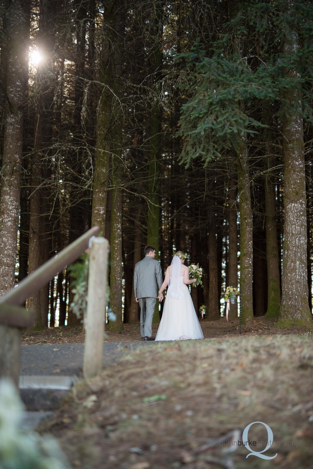 bride and groom walk away from ceremony Perryhill Farm wedding