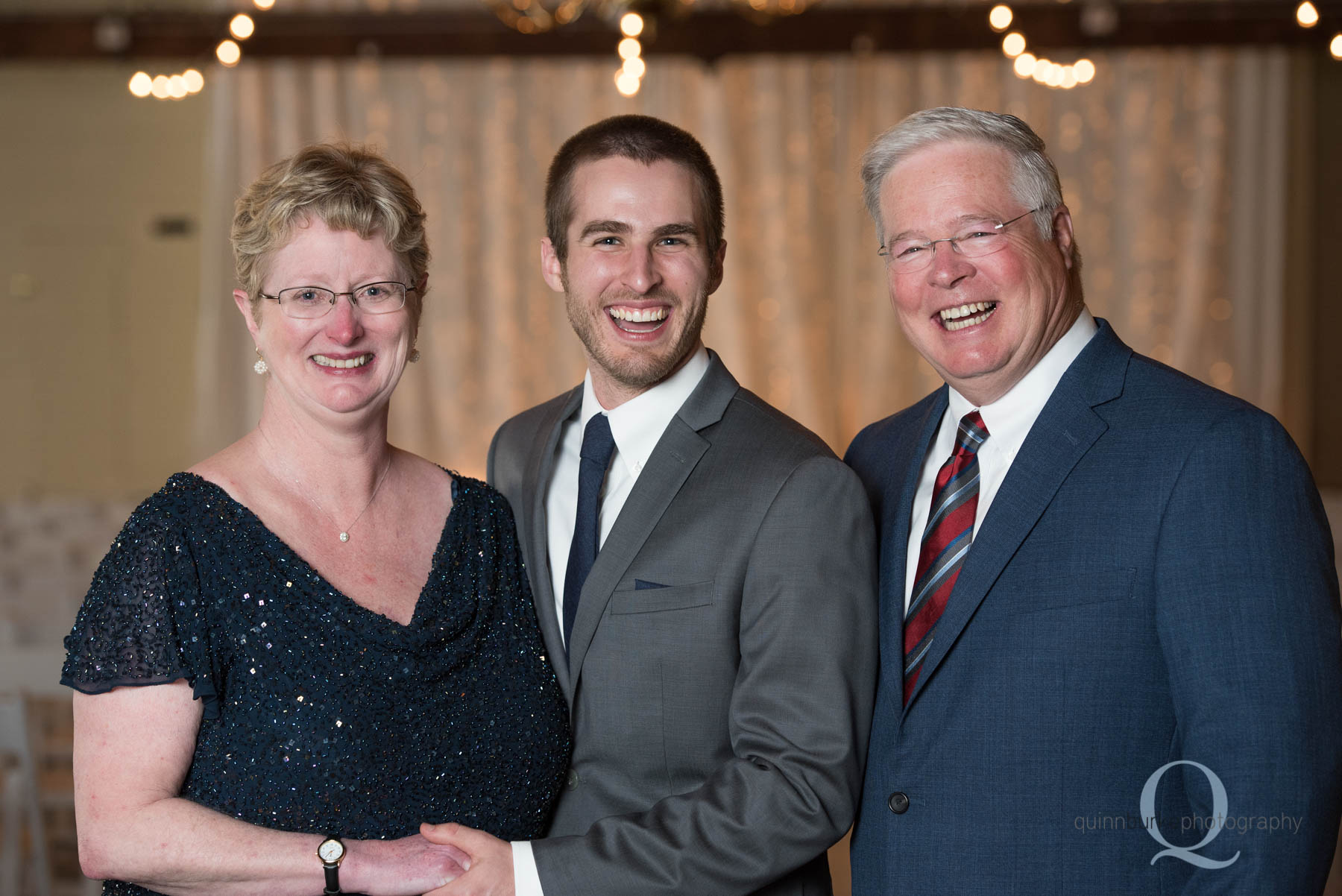 groom and mom and dad before Green Villa Barn wedding