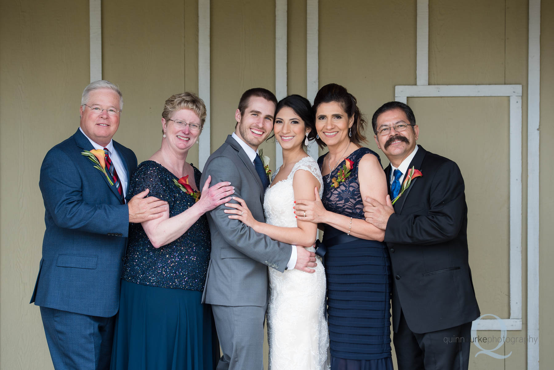 bride and groom with parents at Green Villa Barn wedding