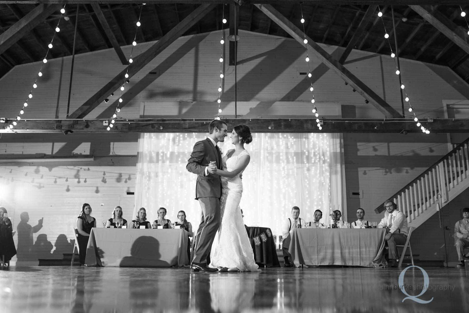 bride and groom first dance in barn at Green Villa Barn wedding