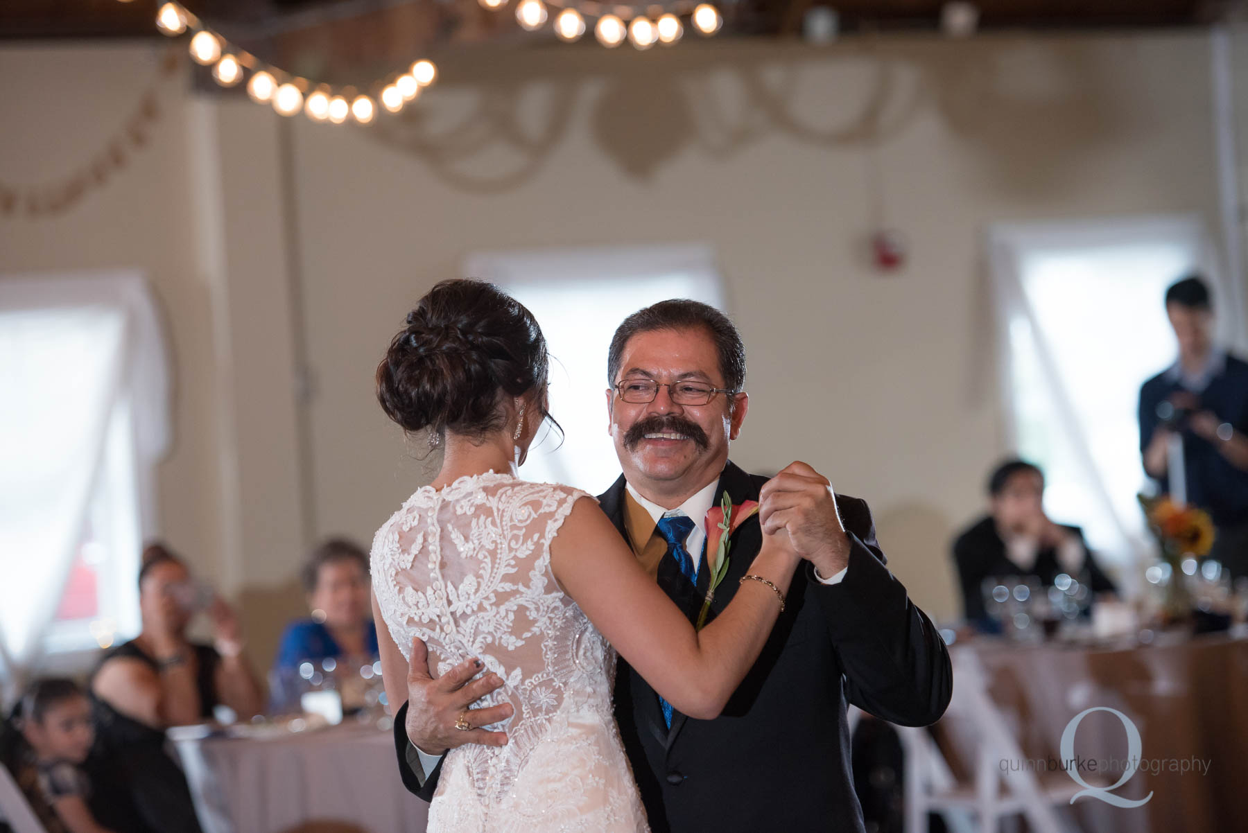 dad dancing with bride daughter during reception at Green Villa Barn