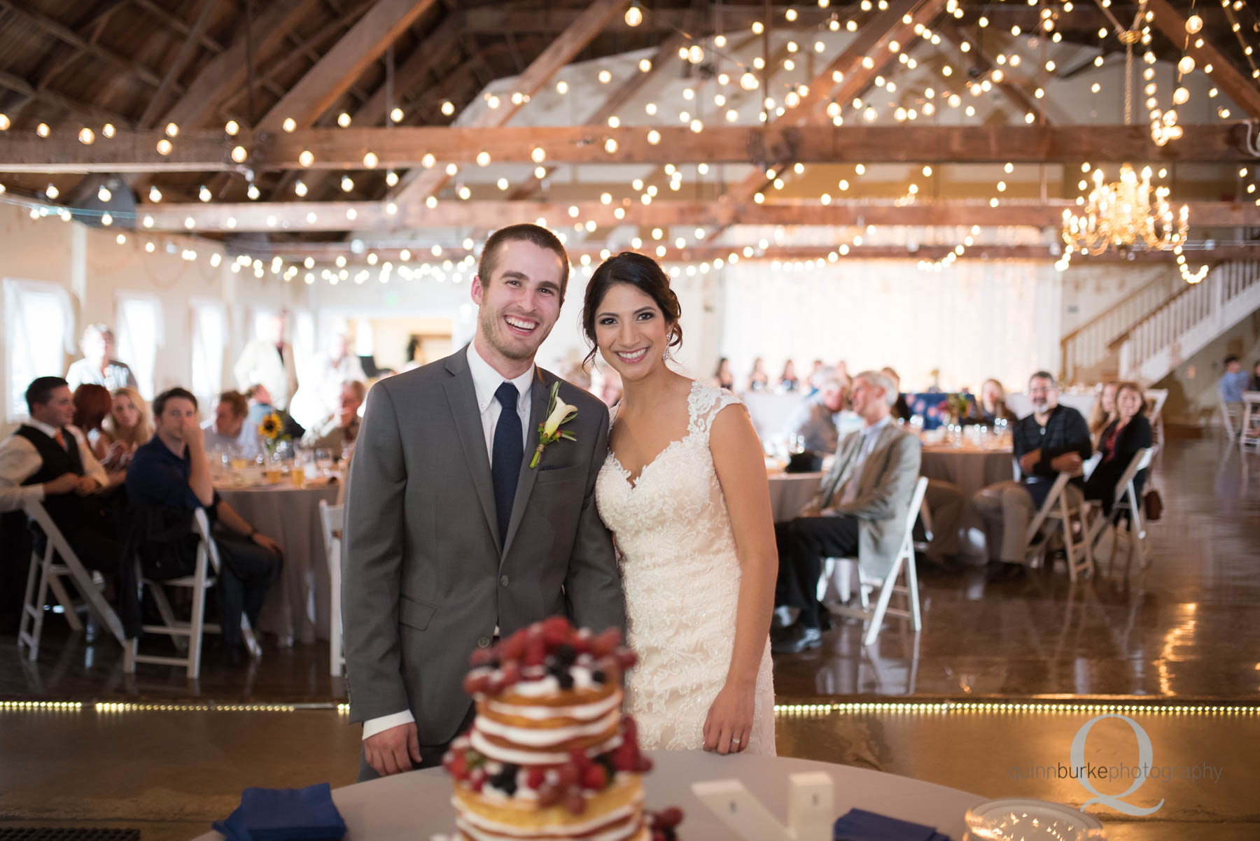 bride and groom with wedding cake at Green Villa Barn