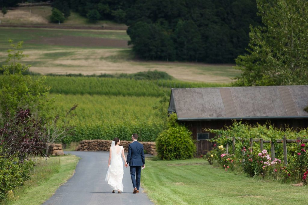 bride groom walking in zenith vineyard wedding outdoor salem oregon