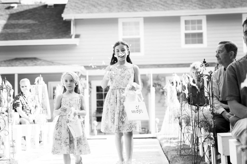flower girls walking down aisle throwing petals salem oregon wedding