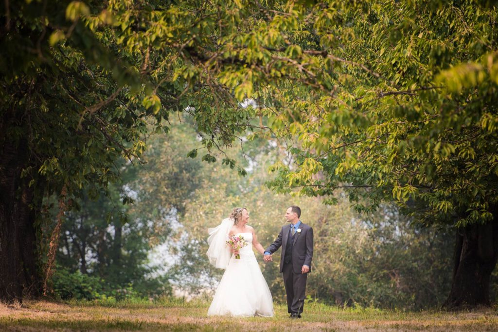 bride groom walk in orchard salem oregon heisler farms wedding