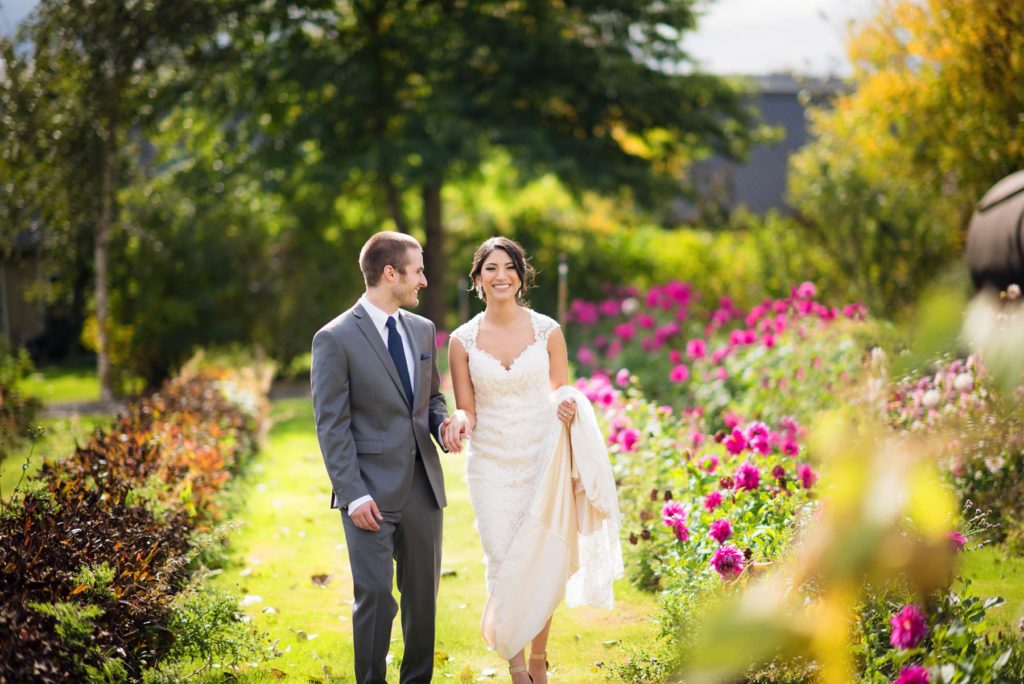 bride and groom walking green villa barn wedding salem oregon