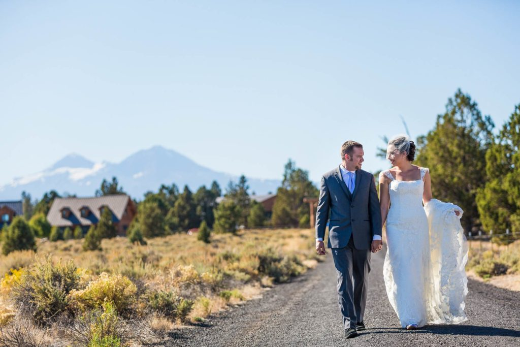 bride and groom walking bend oregon wedding ranch