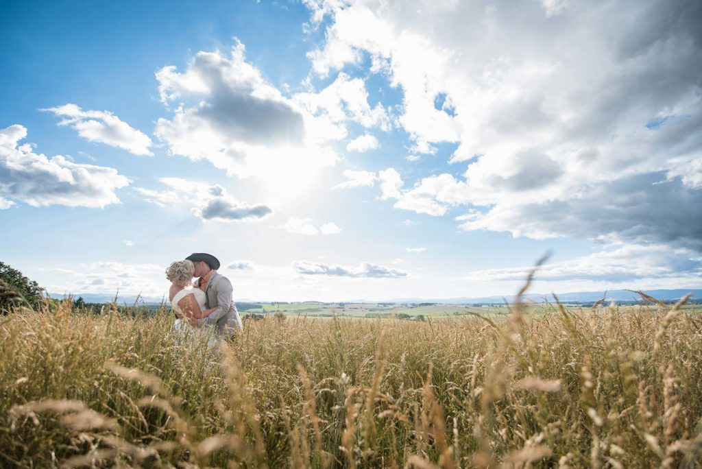 bride groom kiss field big sky ranch wedding salem dallas oregon