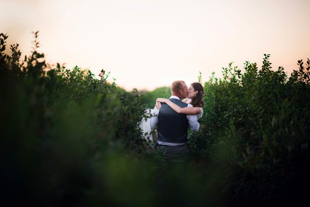 bride groom kiss in field sunset wedding salem oregon