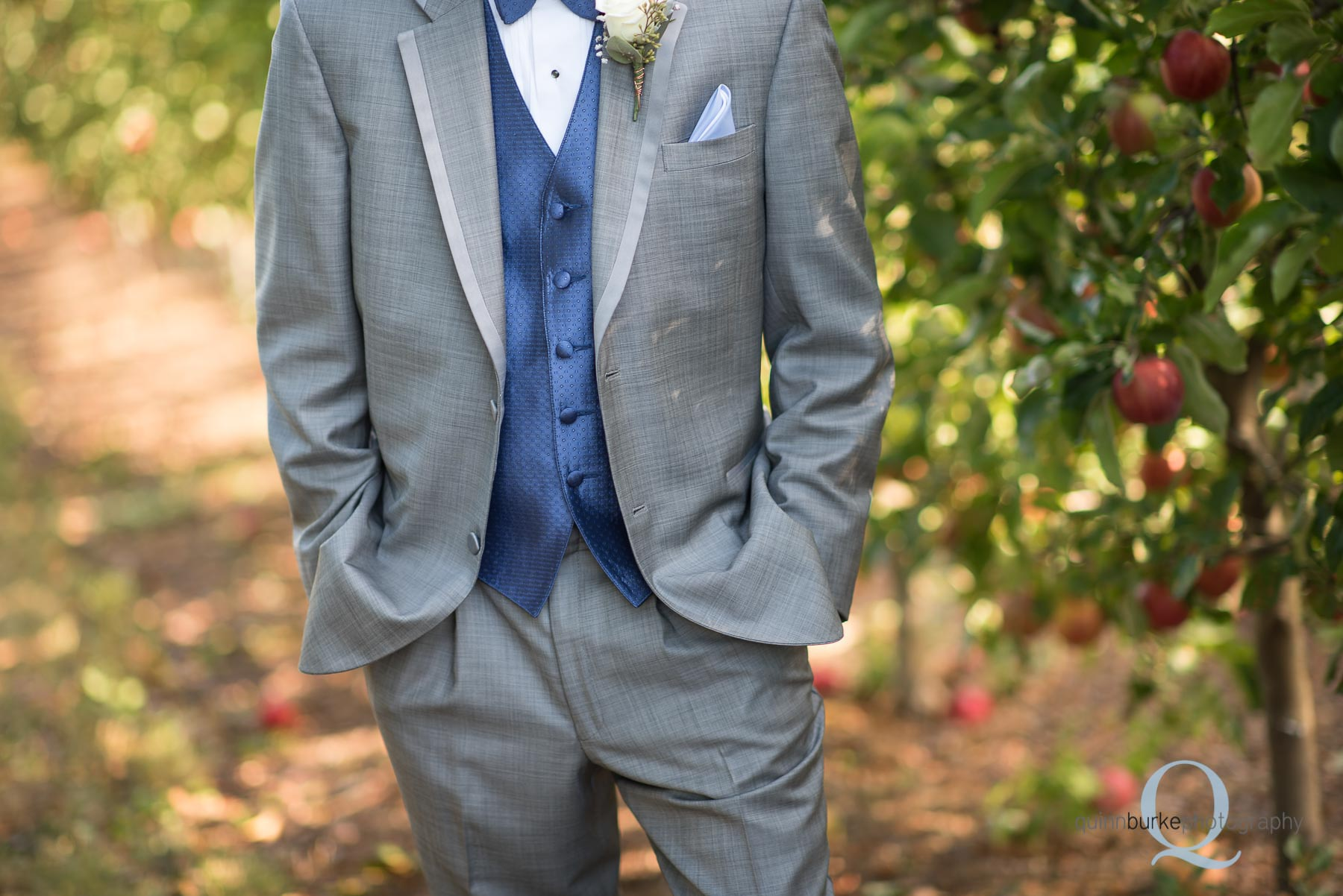 wedding groom in orchard at Perryhill Farm