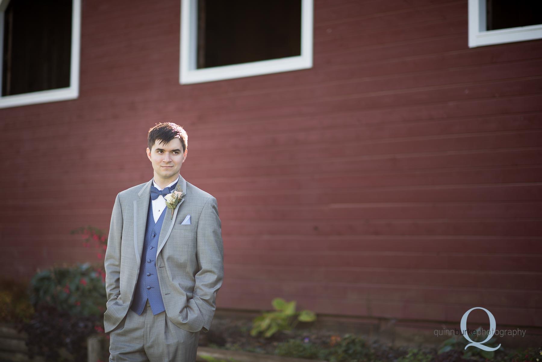 groom outside of barn at Perryhill Farm wedding