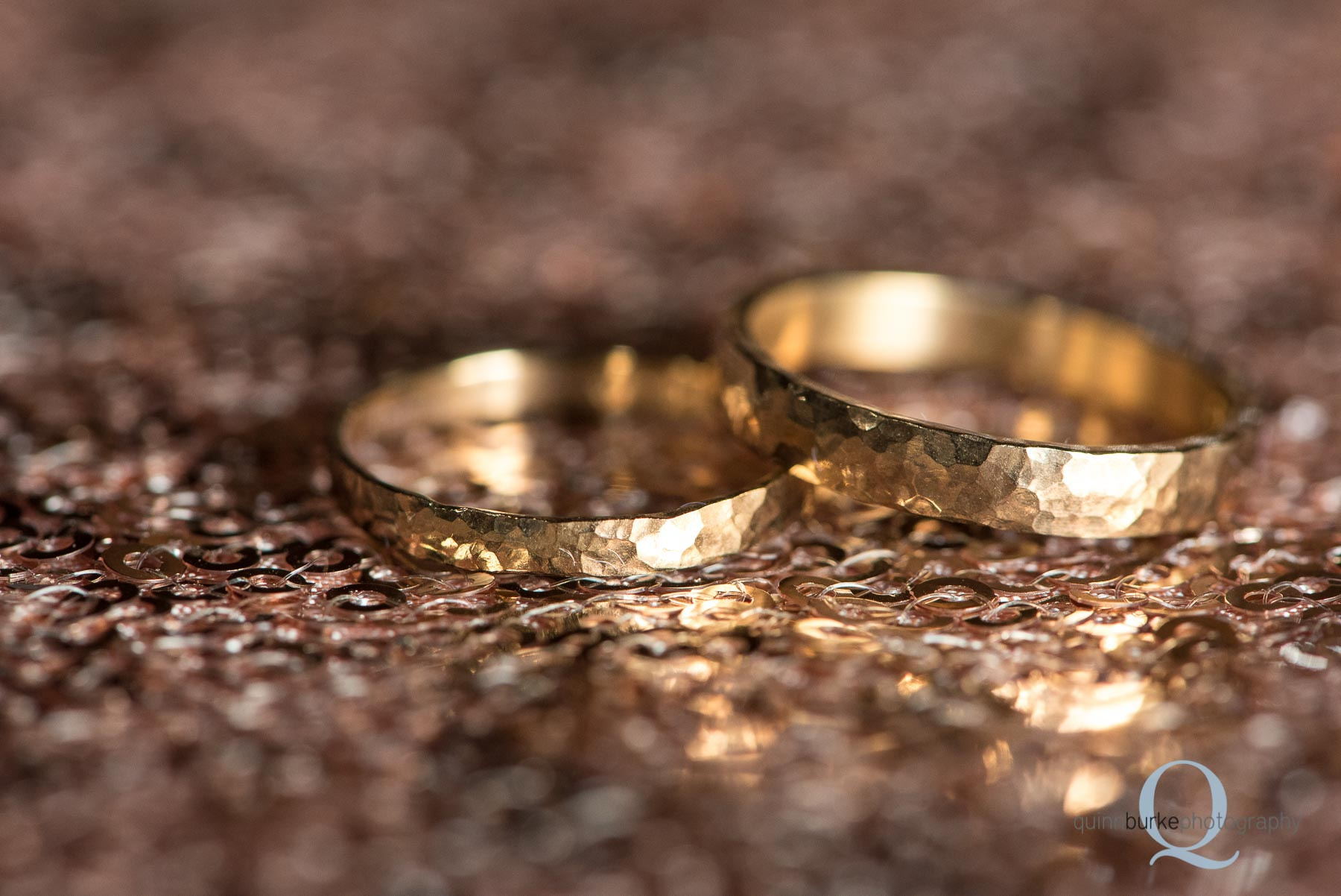 copper wedding rings on sequence cloth at Perryhill Farm