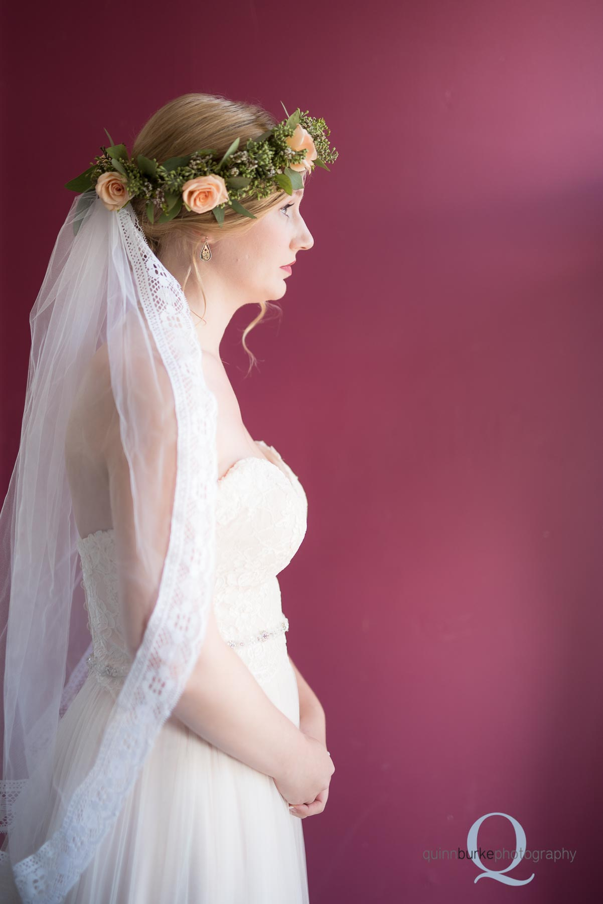 bridal portrait in front of magenta wall wedding