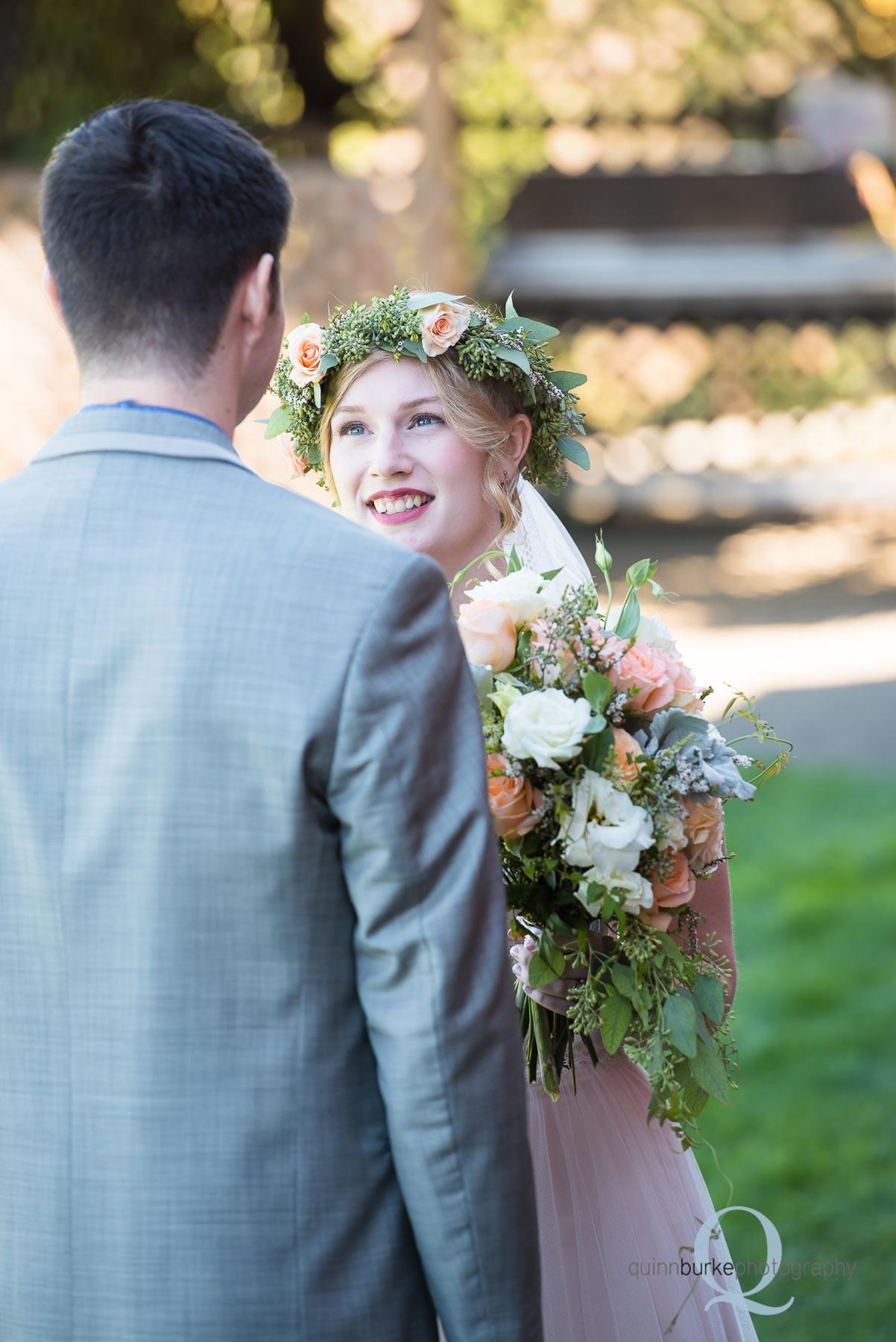 bride looking at groom before wedding oregon