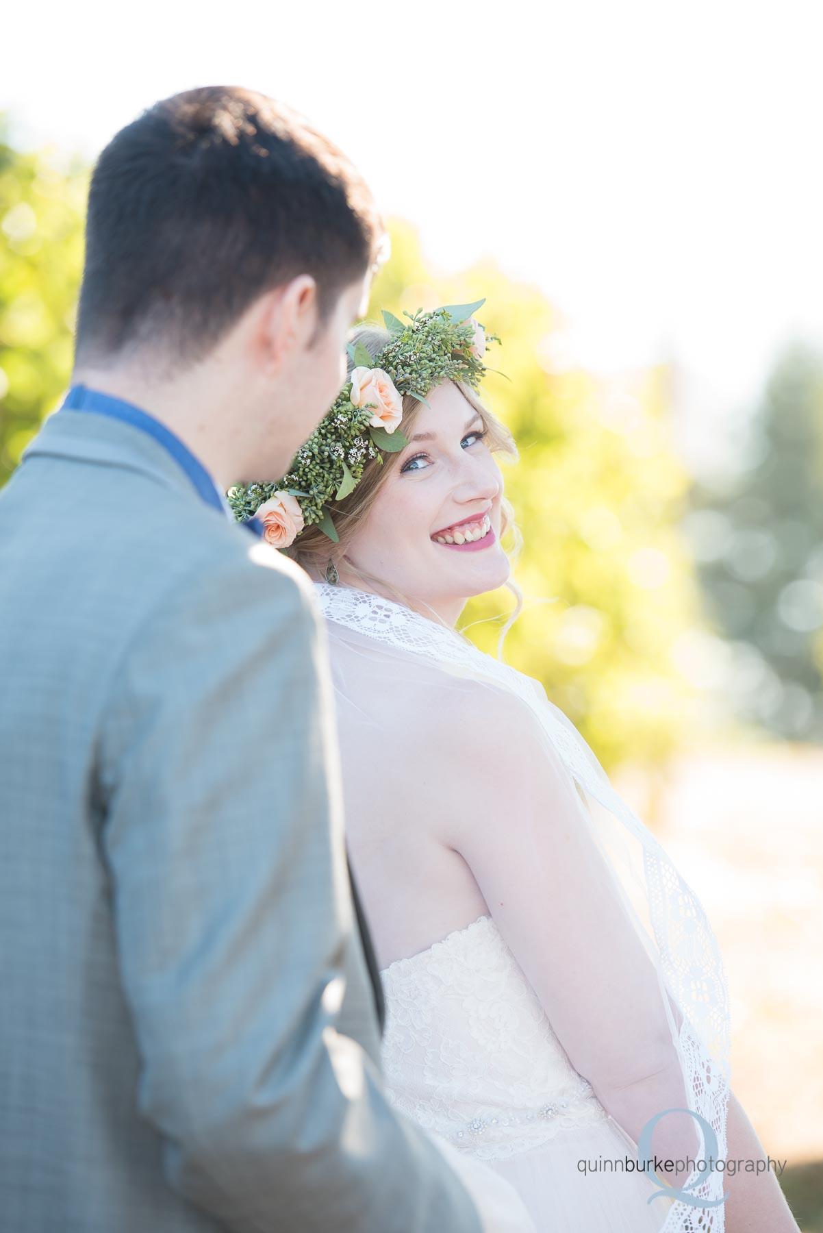 bride looking back at groom Perryhill Farm oregon