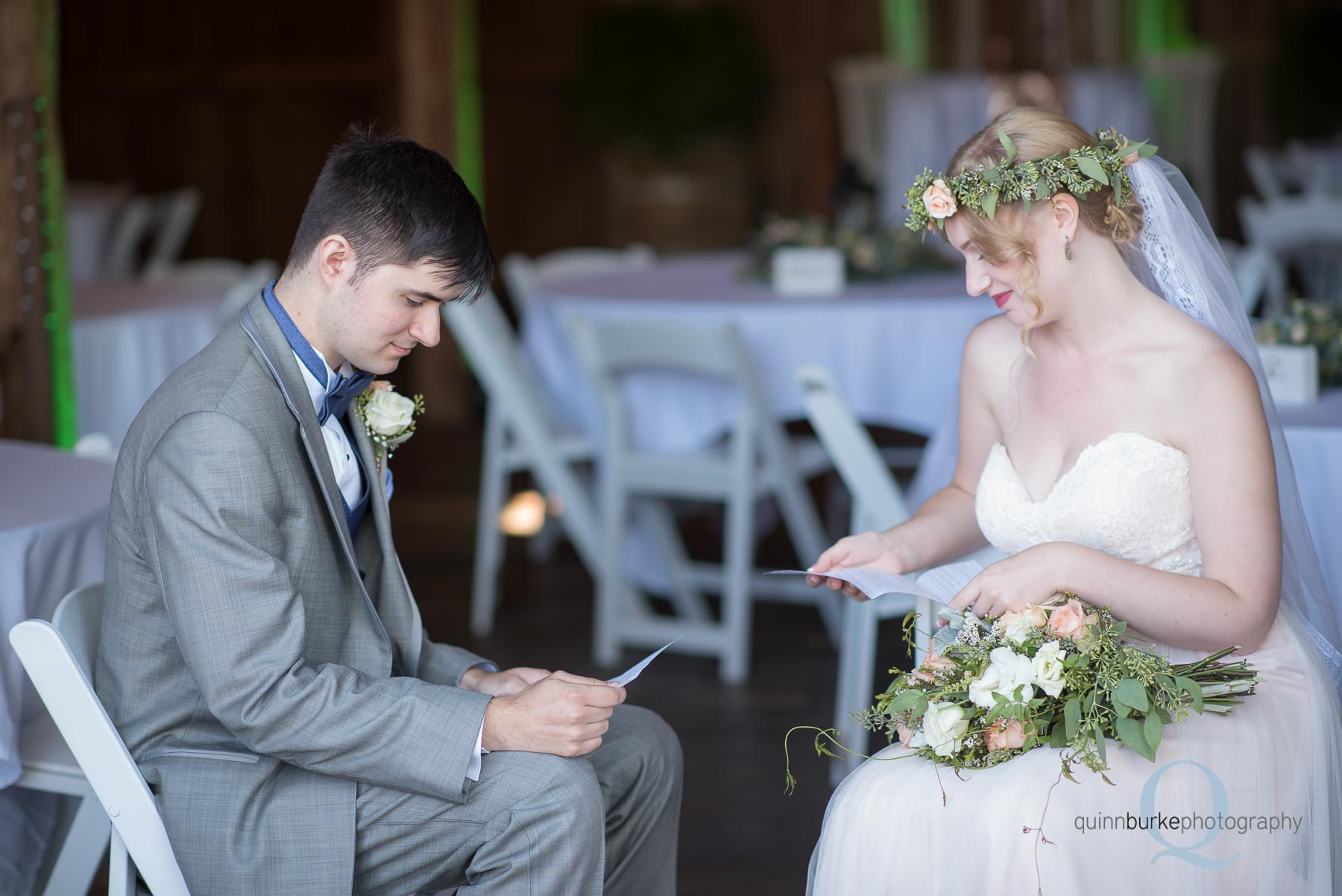 bride and groom reading notes from each other before wedding Perryhill Farm