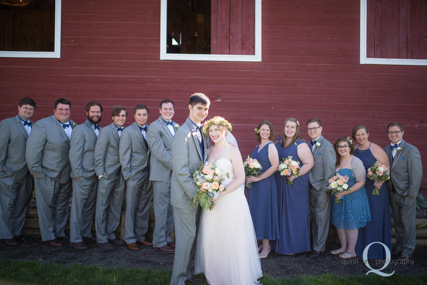 Perryhill Farm wedding party in front of barn