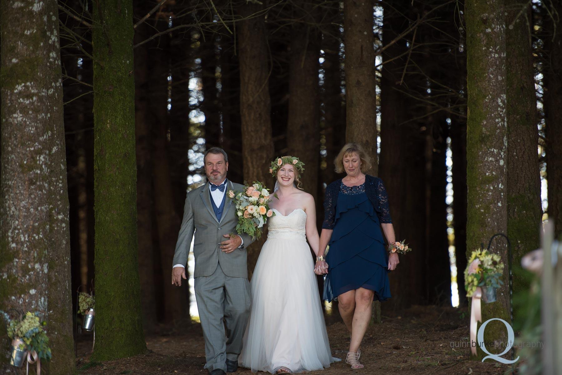 parents walk bride down aisle at Perryhill Farm wedding