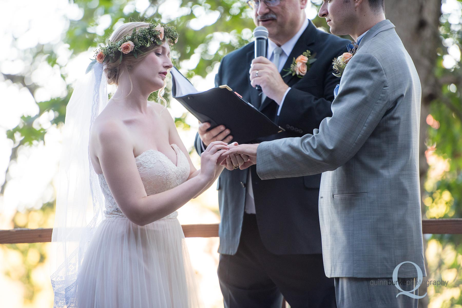 bride placing ring on grooms finger at Perryhill Farm oregon