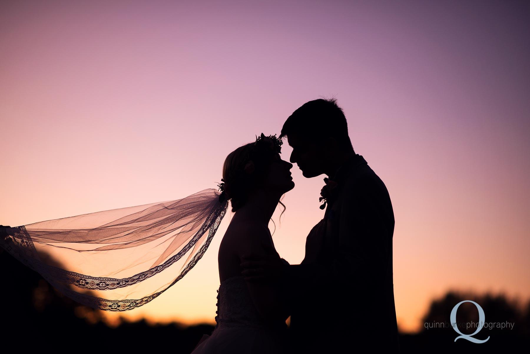 sunset silhouette bride groom barn wedding at Perryhill Farm oregon