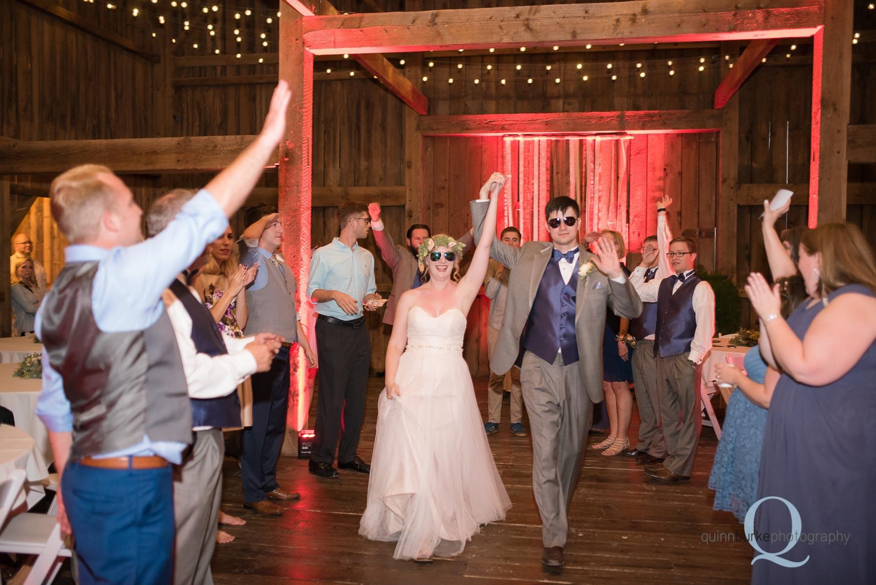 bride and groom exit Perryhill Farm