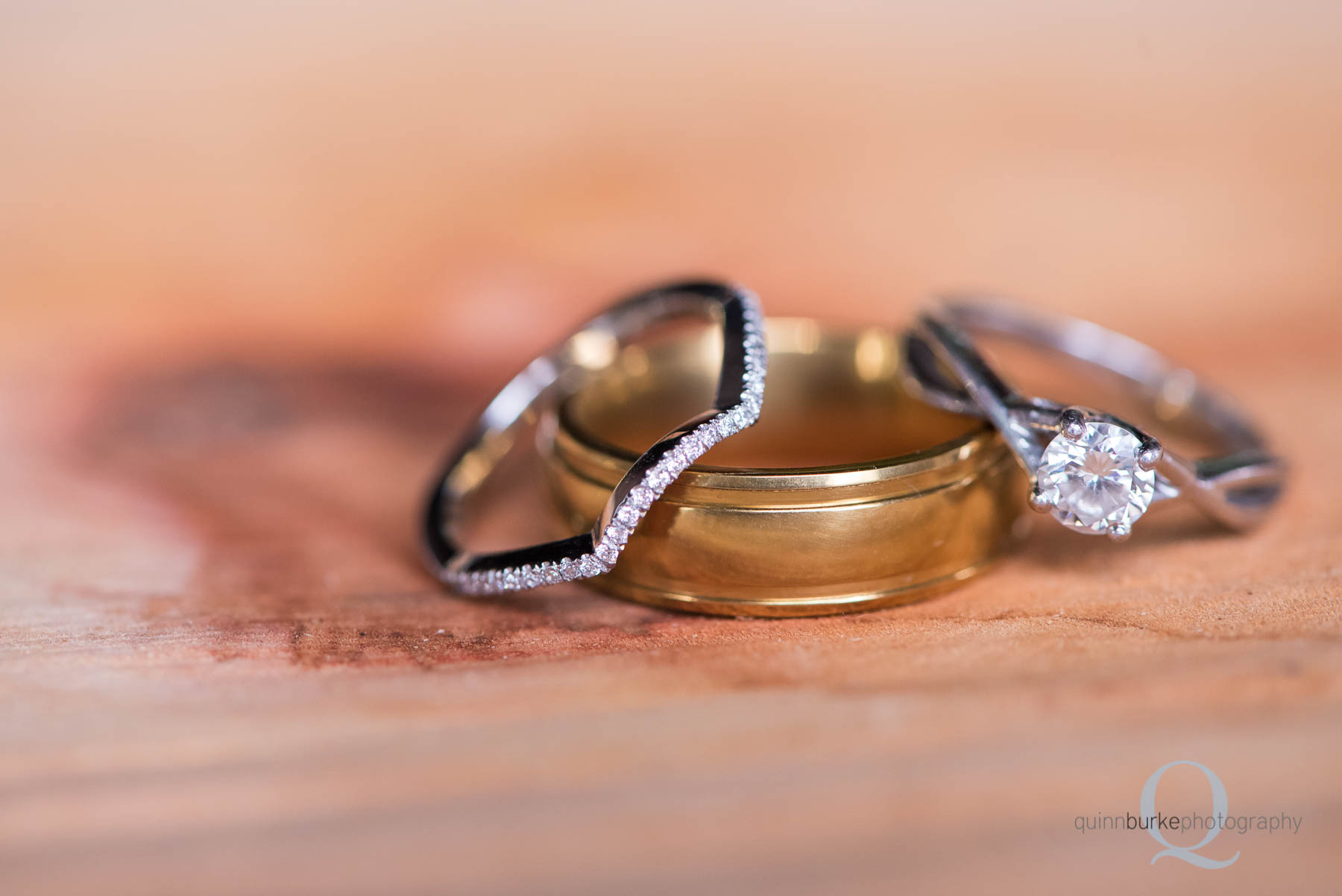 wedding rings on wood cut base