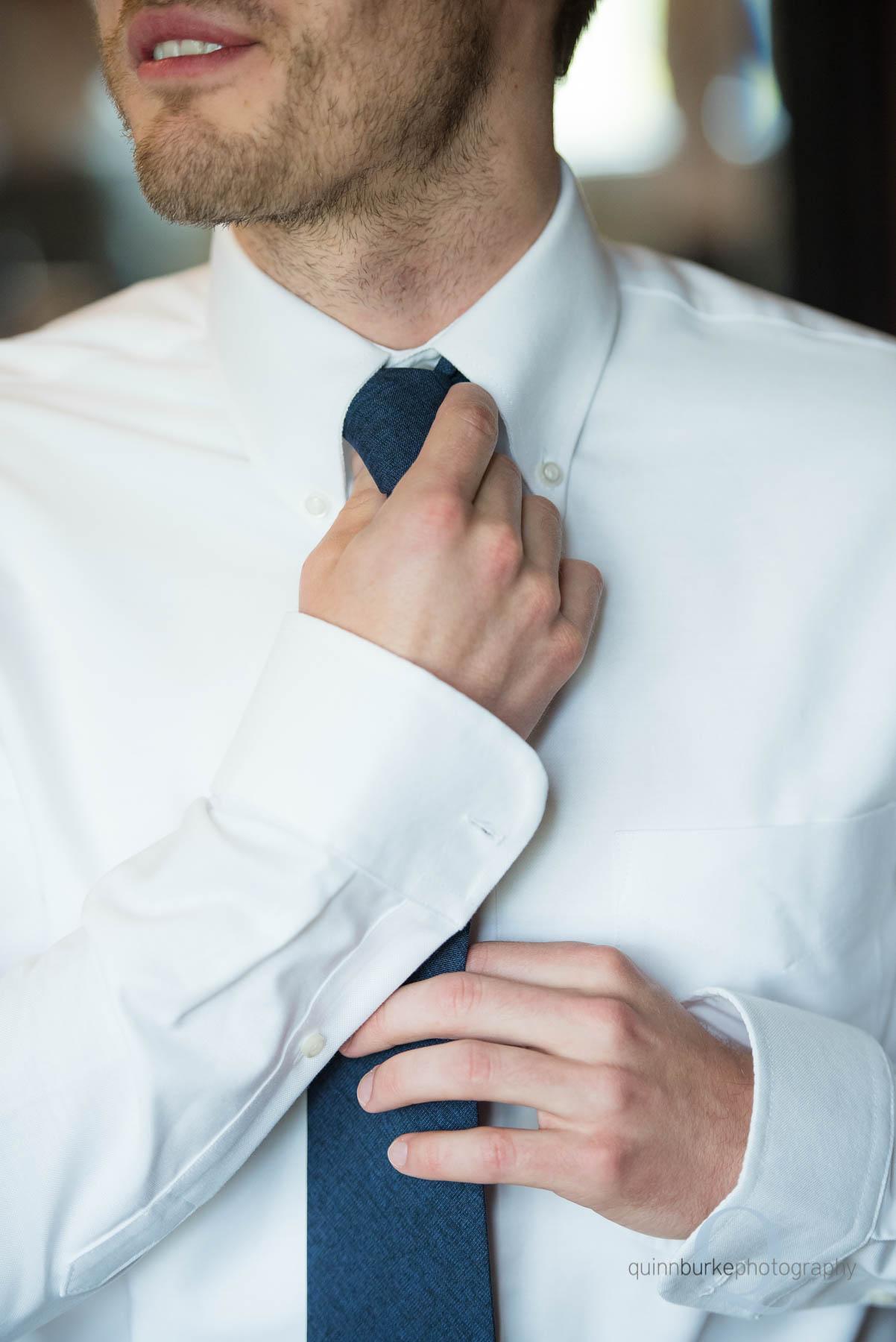 groom straightening tie know at Green Villa Barn