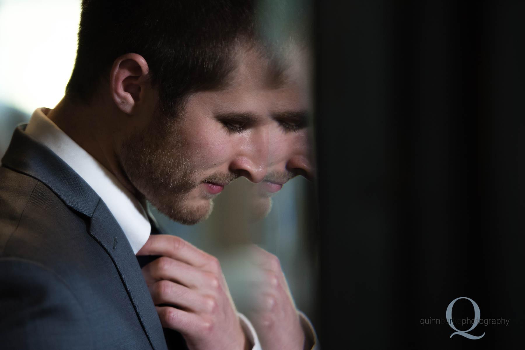 groom in beveled mirror reflection Green Villa Barn