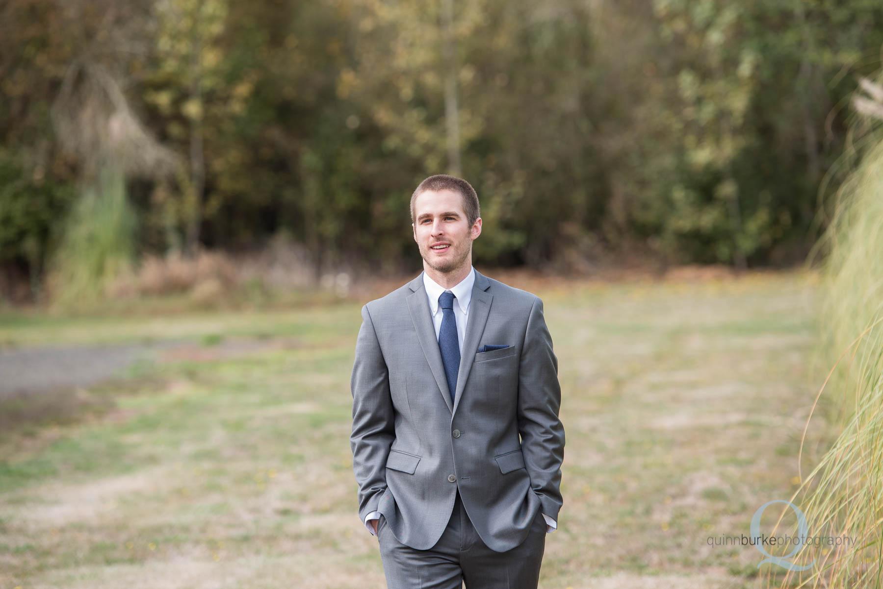 groom walking at Green Villa Barn
