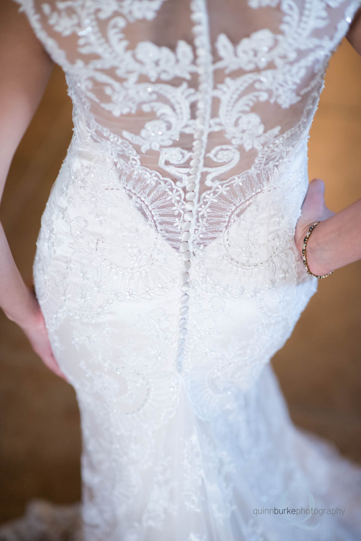 back of bride's wedding dress at Green Villa Barn
