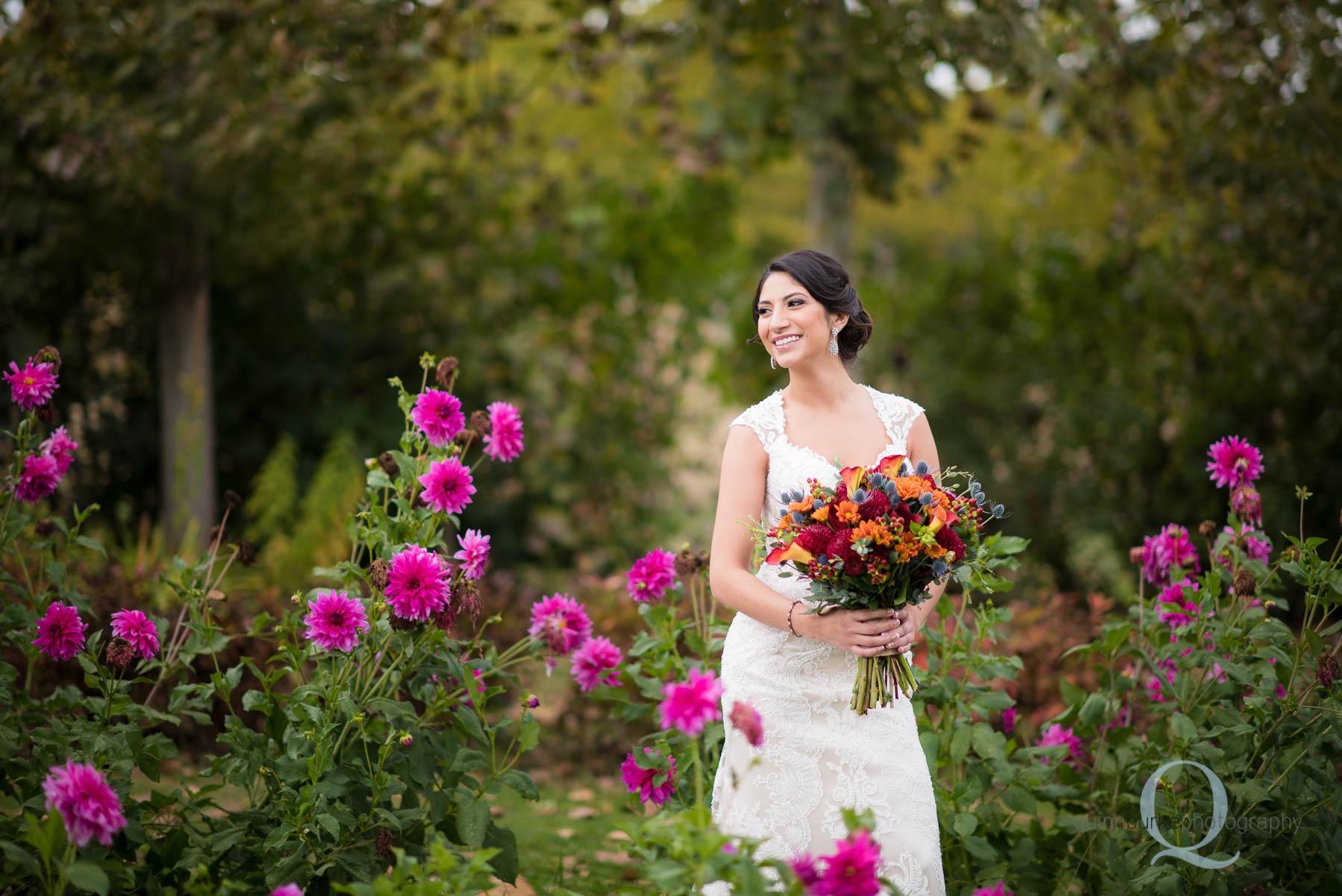 bride in flower garden at Green Villa Barn wedding