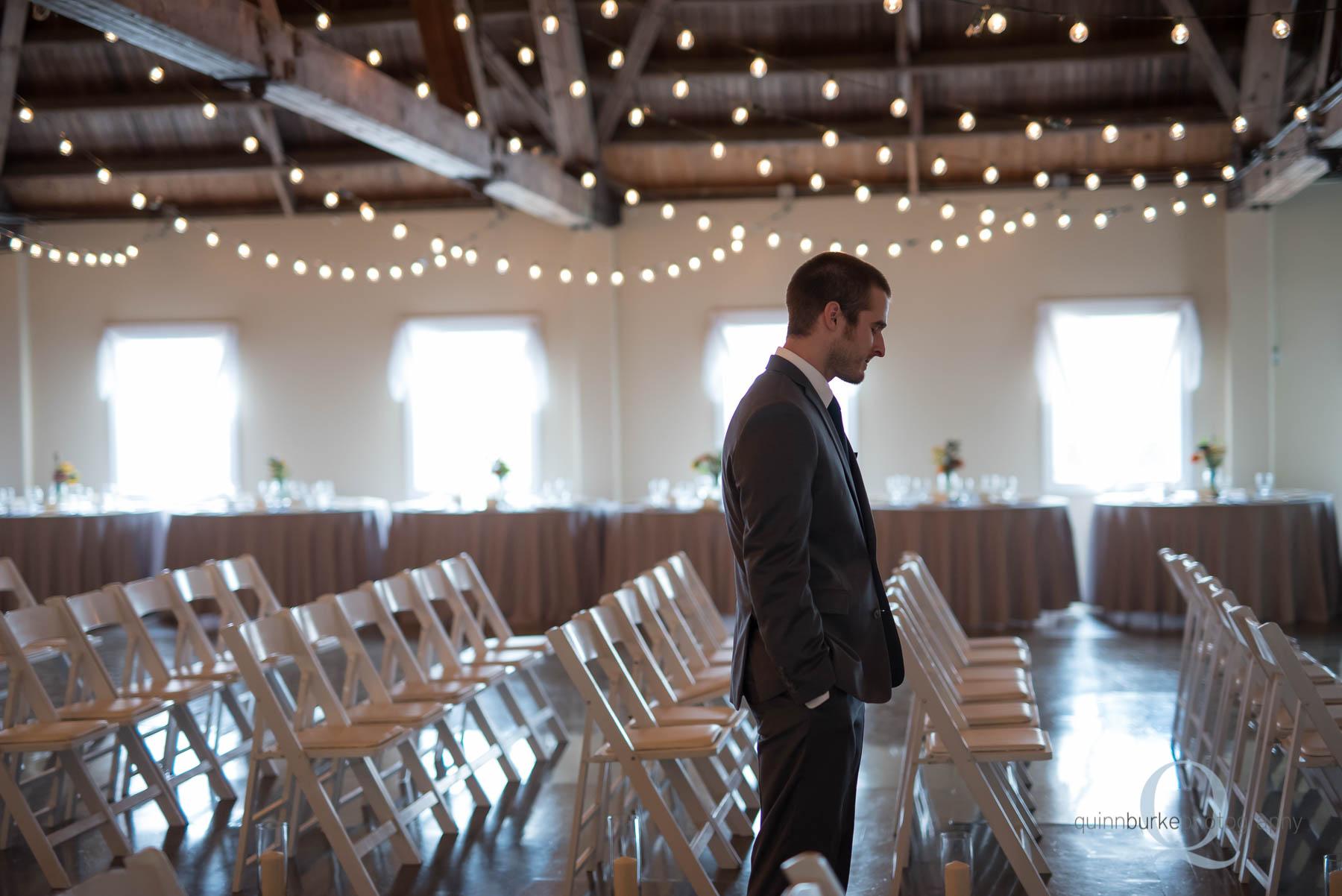 groom waiting for bride first look Green Villa Barn wedding