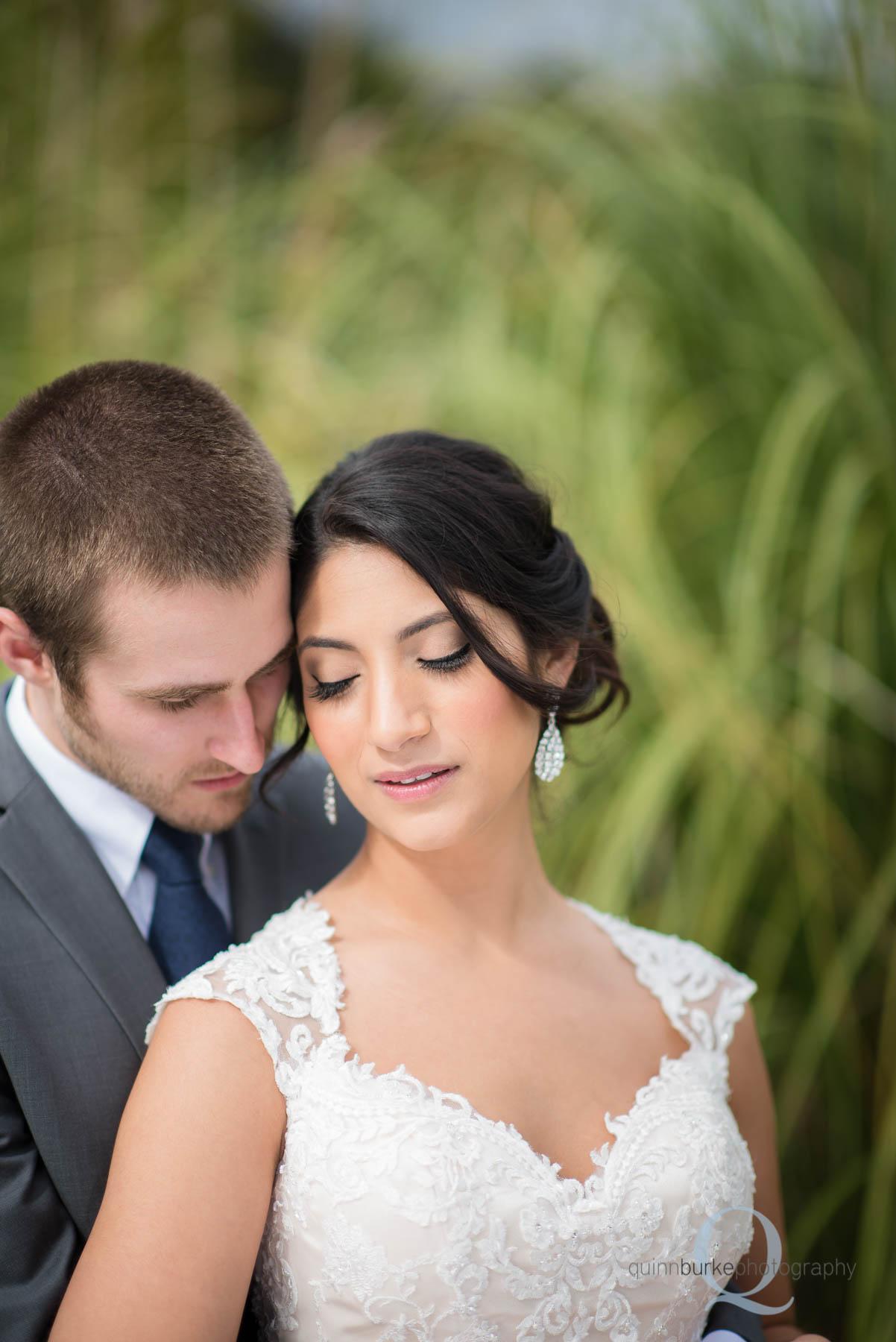bride and groom outside Green Villa Barn wedding