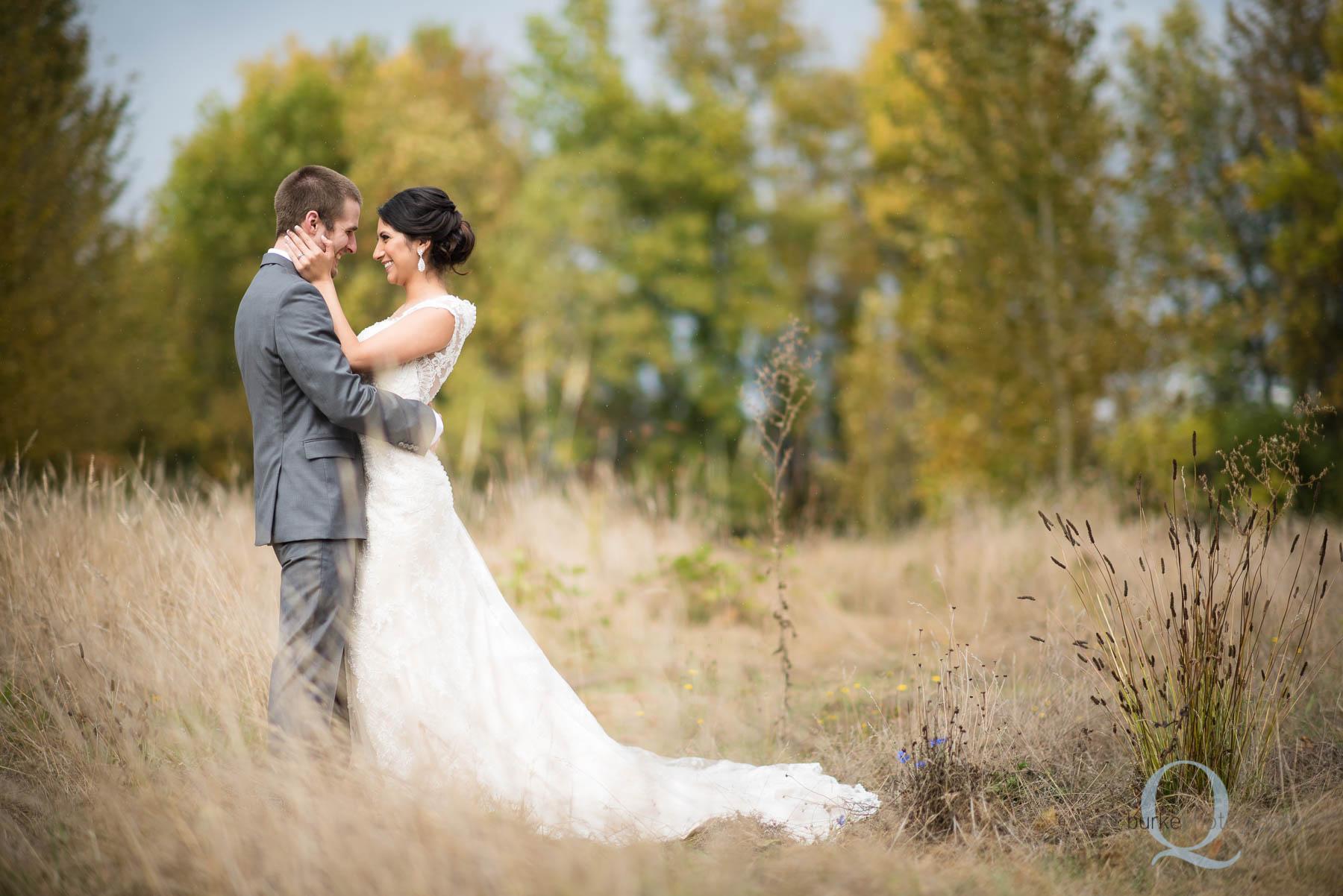 bride and groom in field at Green Villa Barn