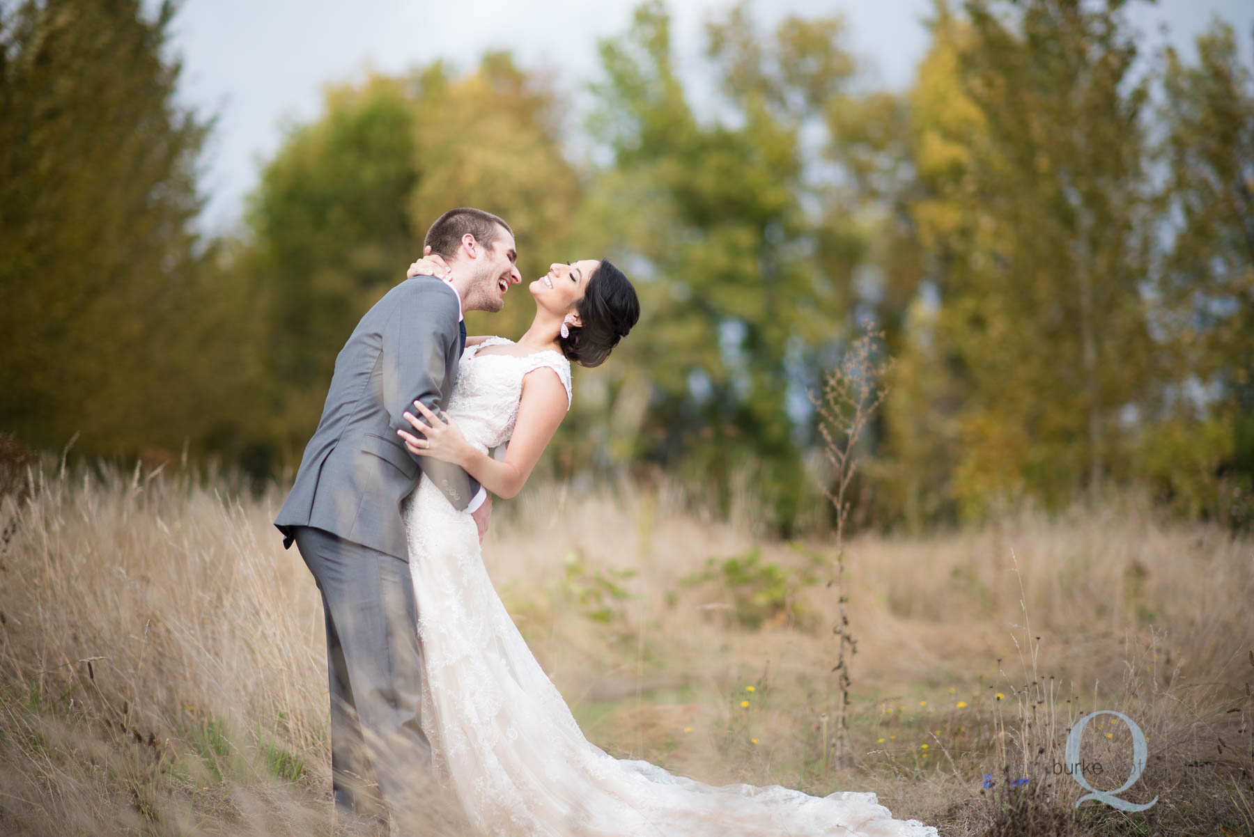 bride and groom laughing at Green Villa Barn wedding