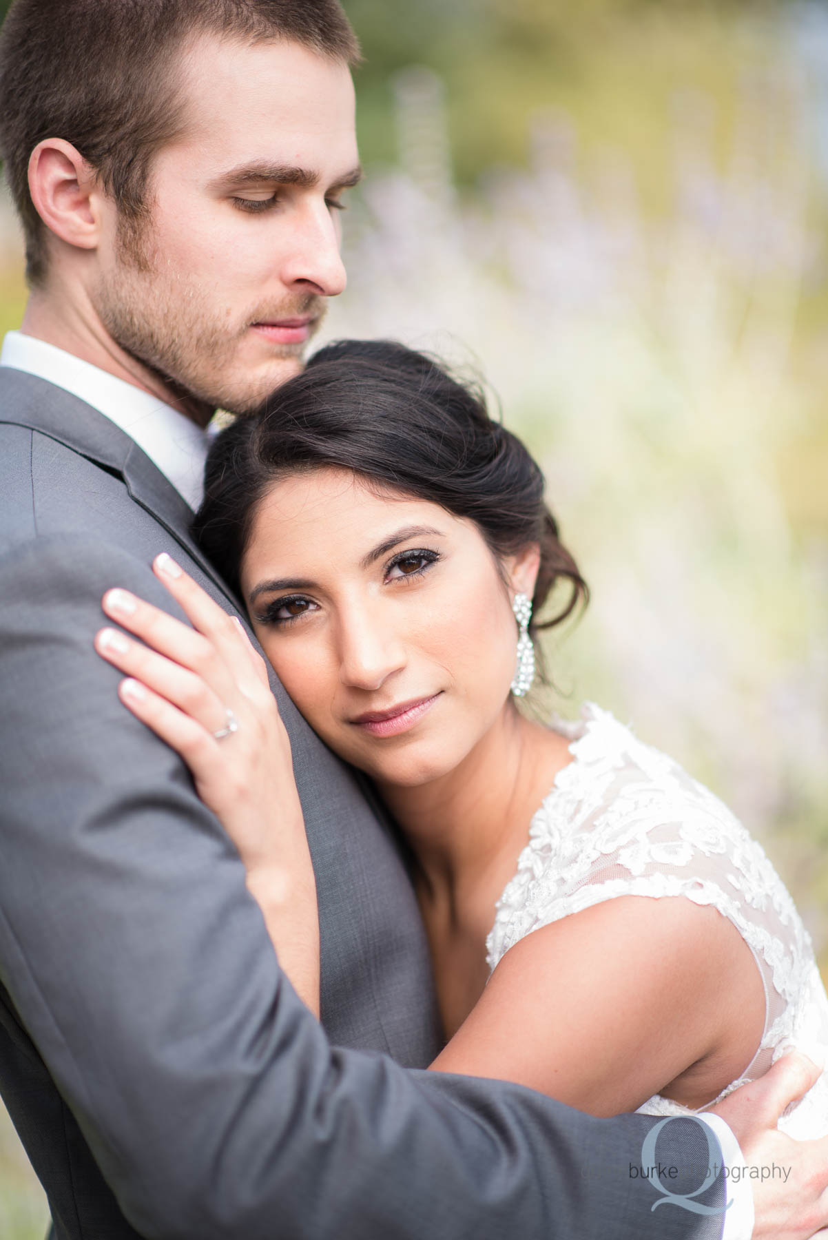 bride with head on grooms chest at Green Villa Barn