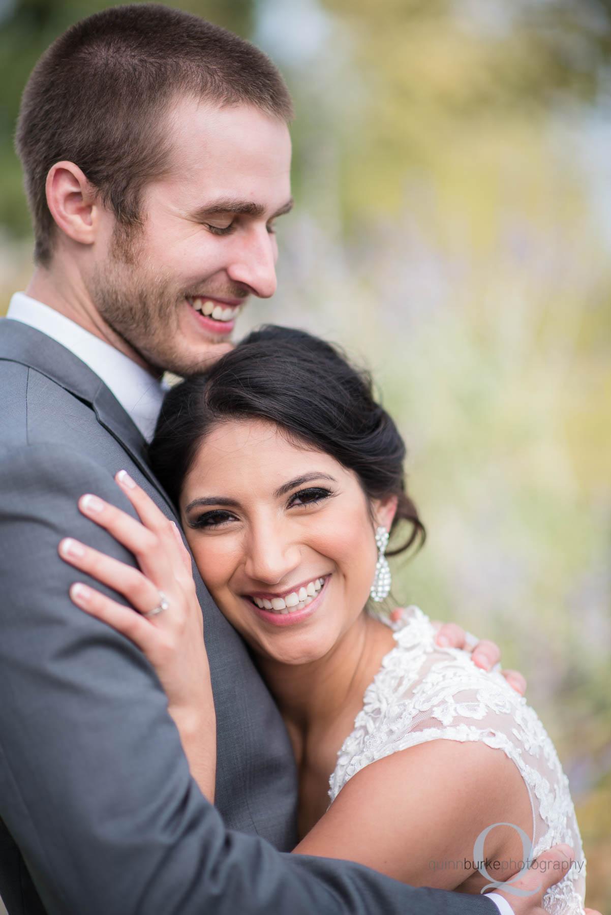 Green Villa Barn bride and groom laughing