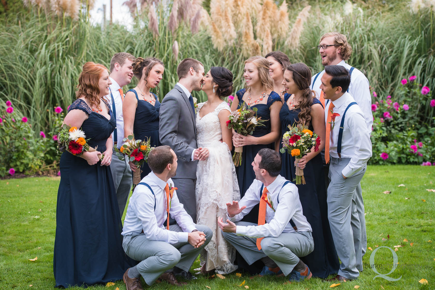 Green Villa Barn wedding party bride and groom kissing