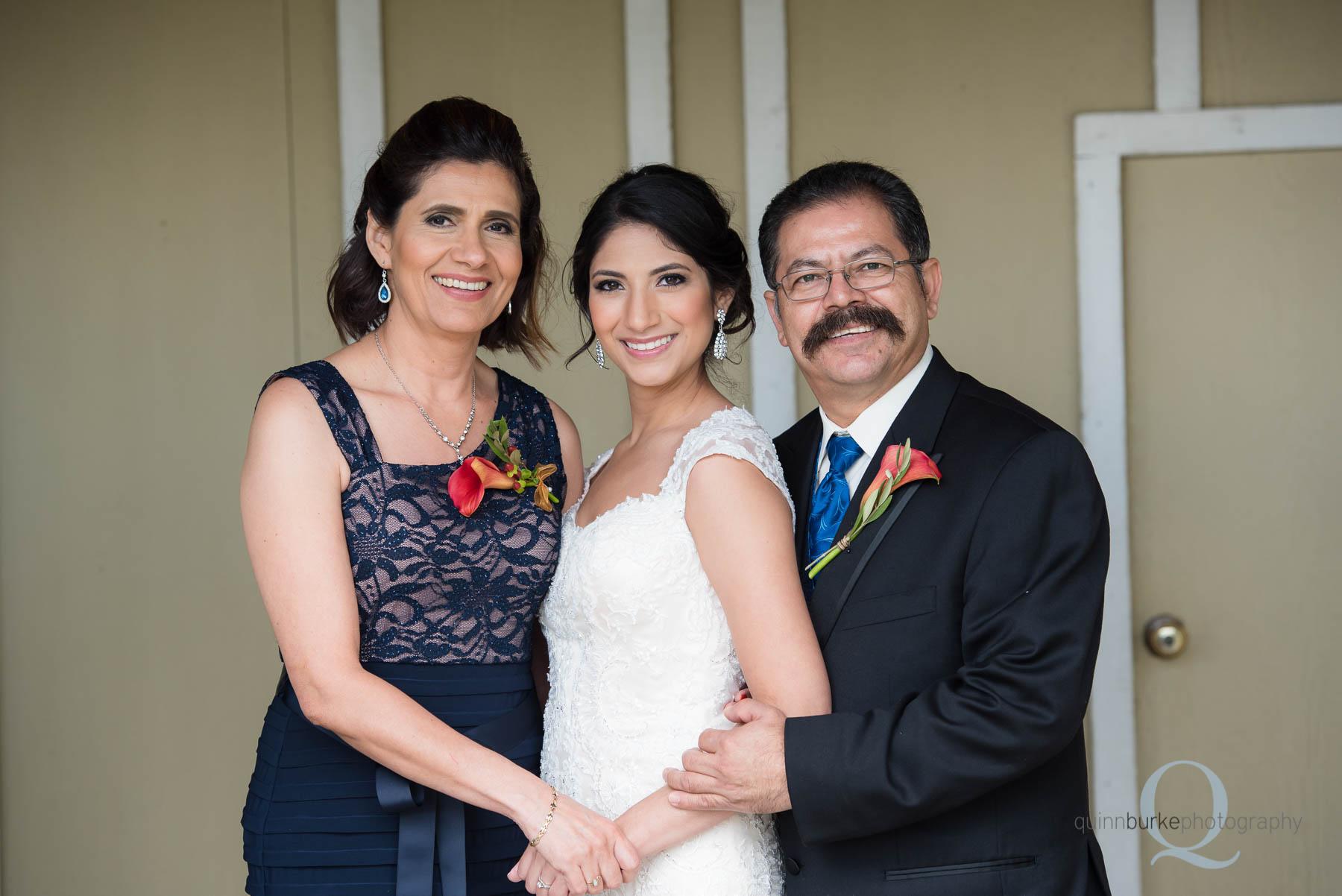 bride with mom and dad before wedding at Green Villa Barn