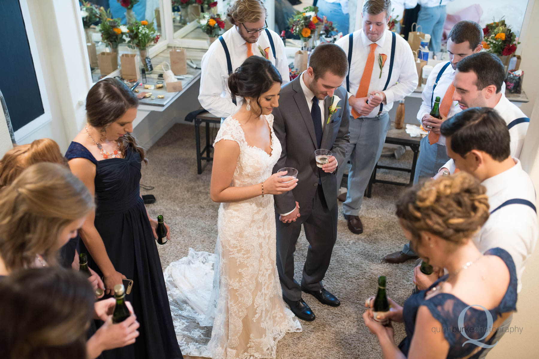 praying for bride and groom before wedding at Green Villa Barn