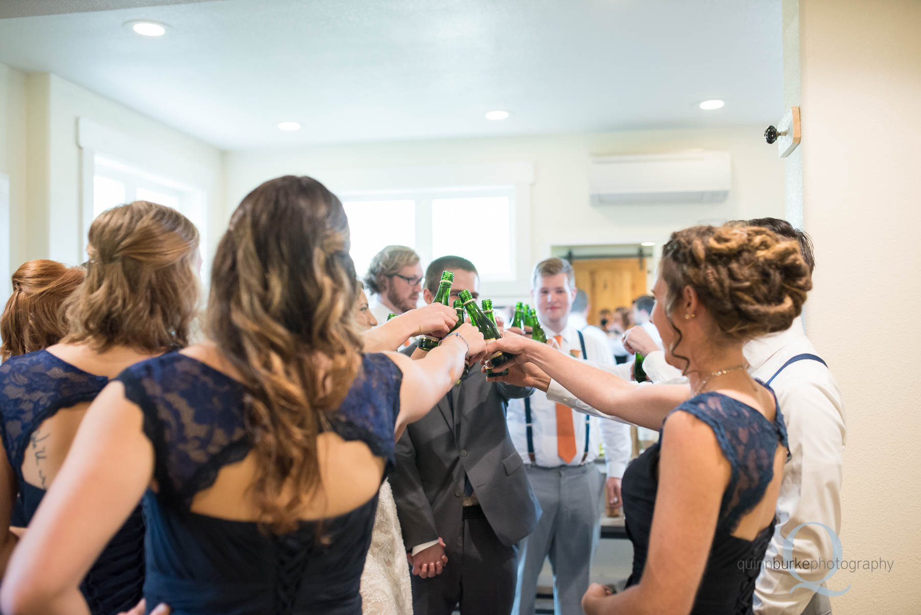 wedding party toasting together before wedding
