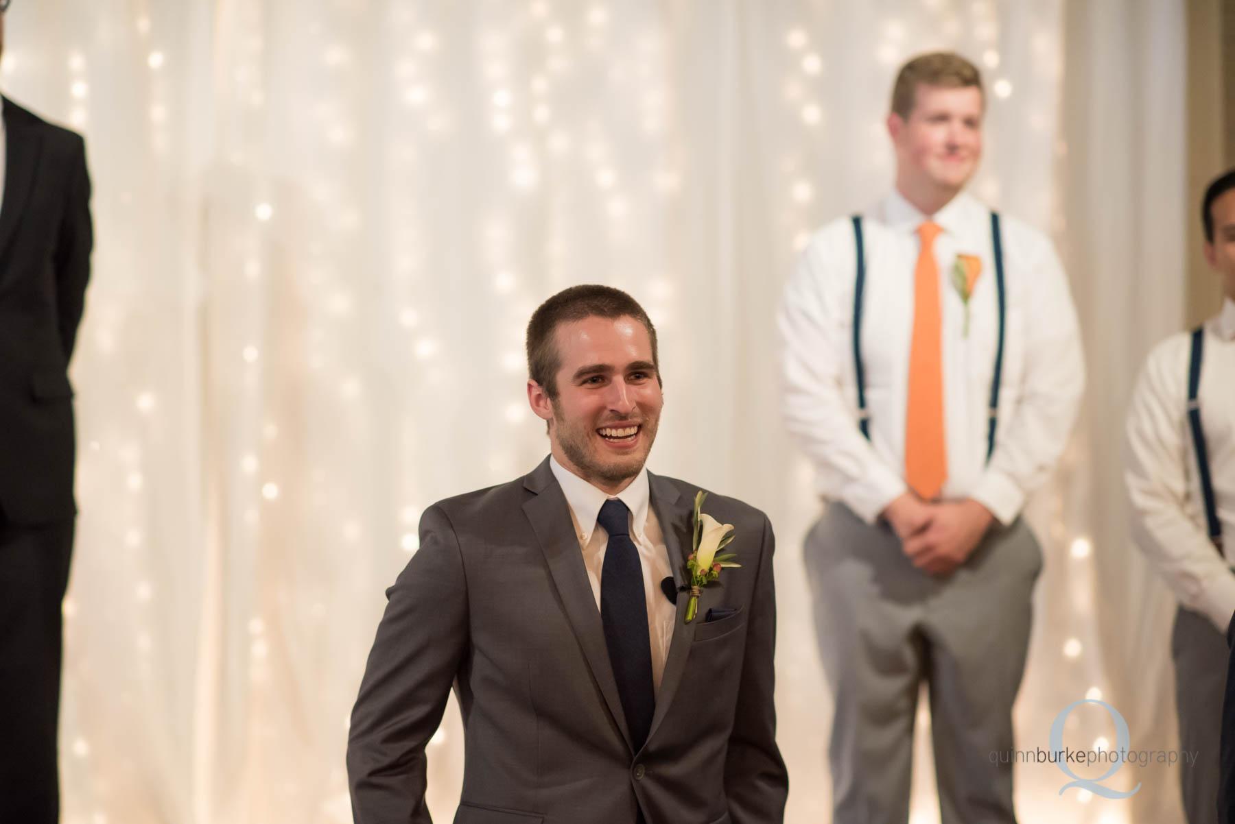 emotional groom sees bride at wedding ceremony at Green Villa Barn