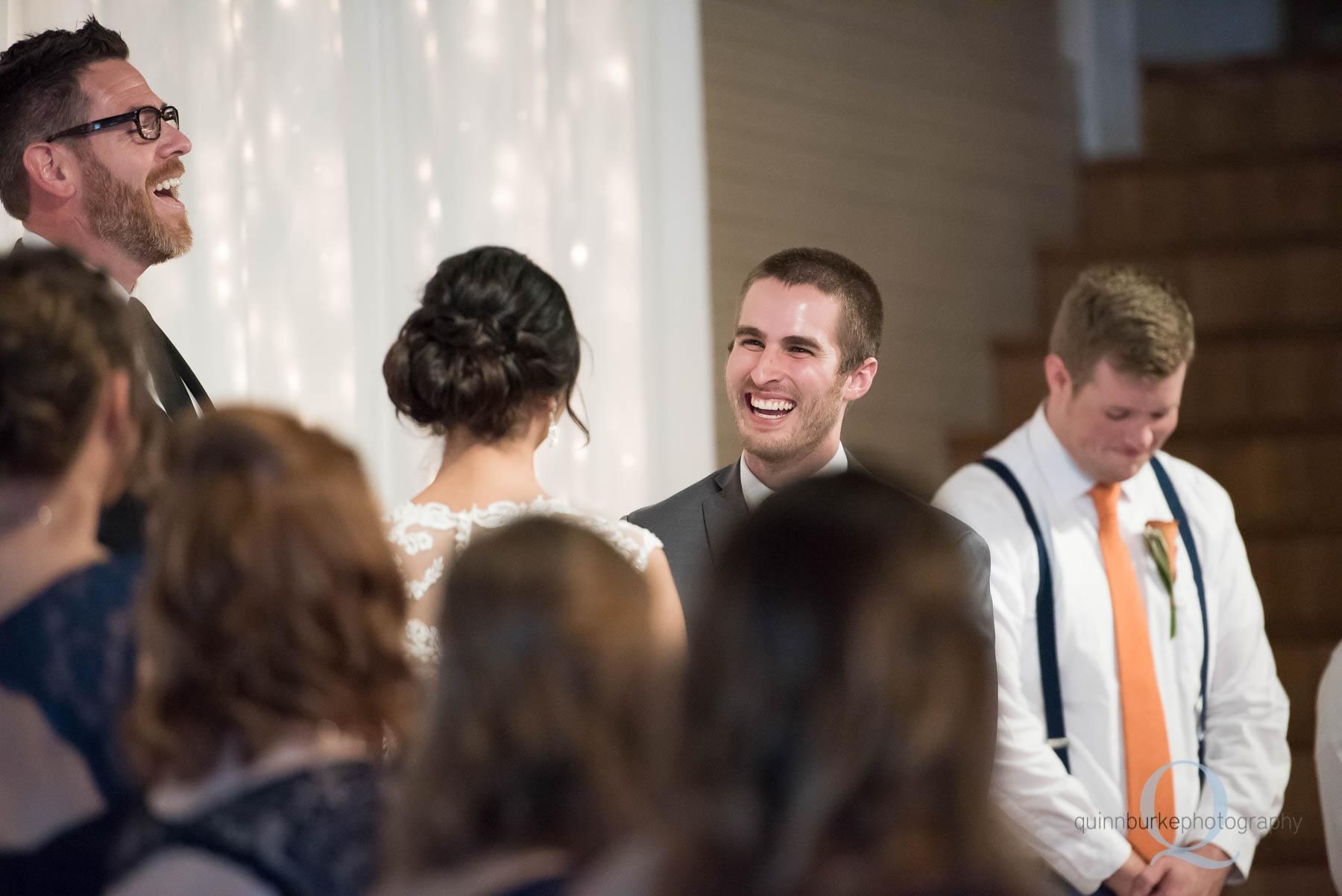 groom during wedding ceremony Green Villa Barn